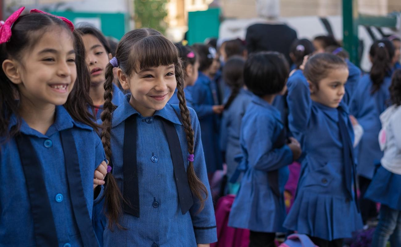 Photo: Students line up for morning activities at Khawla Bint Tha'laba Primary Girls School, located in Sweileh, Jordan.