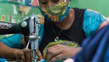 Photo: A photo of youth in DRC sewing face masks.