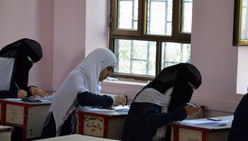 Photo: Girls take exams in refurbished school